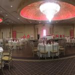 A wide shot of a banquet hall with an array of tables