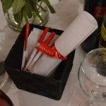A box with several pens and a diploma for display
