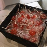 A photo of a box full of 50th anniversary red candies