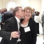 A man kissing on a woman\'s cheek