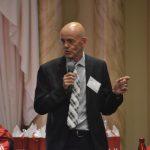 Merv Mosher speaking into a microphone