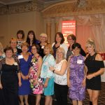 A small group photo of women at the banquet